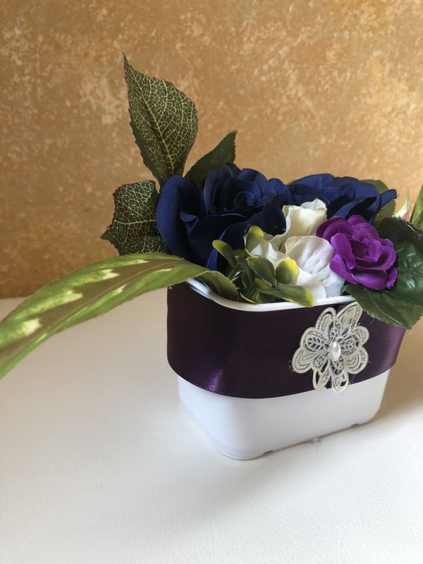 Pot of fake flowers