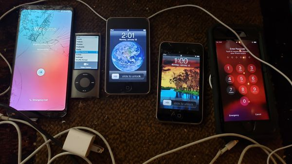5 phone lot lg style 4, 2 original ipod touches, ipod nano with camera' and iPhone s plus cords n headphones