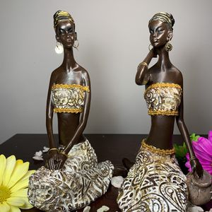 Beautiful African Women figurines dressed in white and gold. Real fabric and trim. Gold wire. for Sale in Hialeah, FL