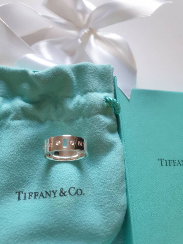 Authentic Tiffany & Co . Lock Diamond sterling silver ring size 6