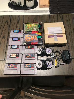 Super Nintendo with two controllers and 10 games. Missing AV cord for Sale in Rancho Cucamonga, CA