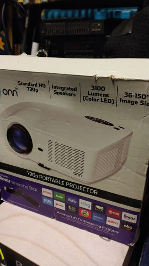 Onn 720p portable projector w/Roku streaming stick,integrated speakers,standard HD,3100 lumens,36-150' image size for Sale in Grover Beach, CA