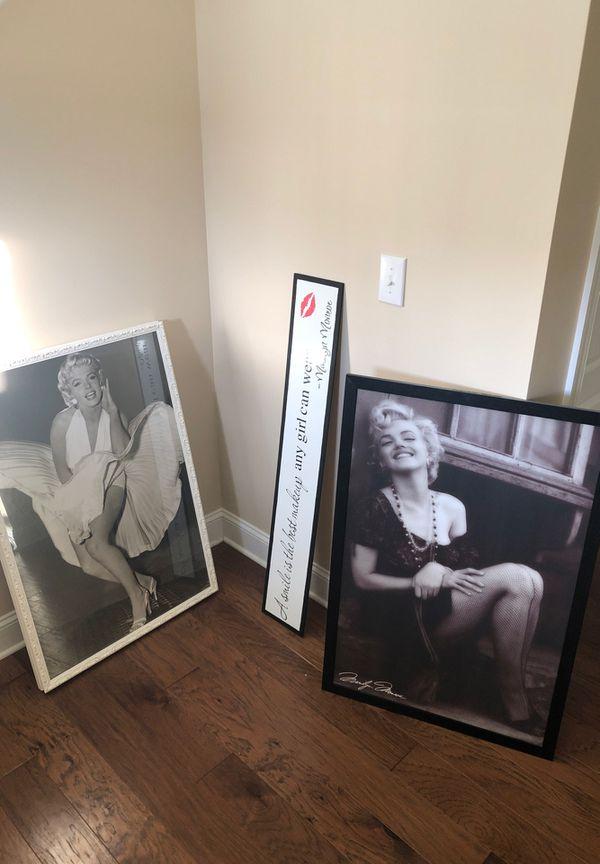 Framed Marilyn Monroe prints and banner