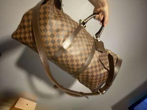 LOUIS VUITTON 55 duffle bag for Sale in Orlando, FL
