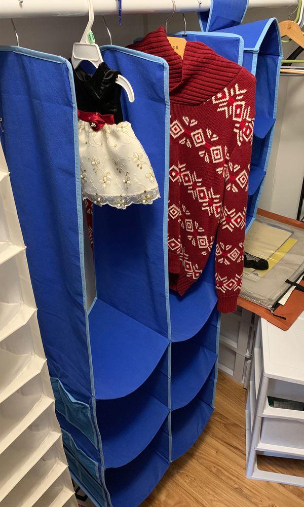 Kids closet divider with racks.