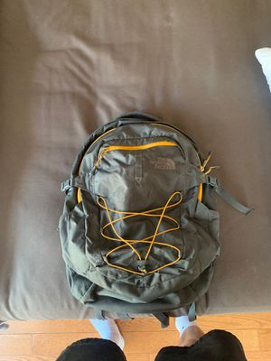North face grey and orange back pack for Sale in Boulder, CO