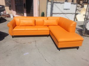 NEW 9X7FT ORANGE LEATHER SECTIONAL CHAISE for Sale in Indio, CA