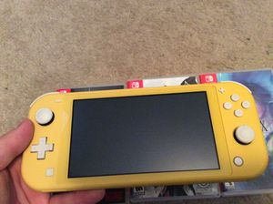 Nintendo switch lite yellow with 64gb microSD, handles, and 3 games. for Sale in Palm Bay, FL