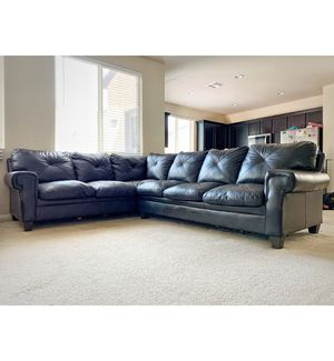 RC WILLEY black faux leather sectional couch for Sale in Las Vegas, NV