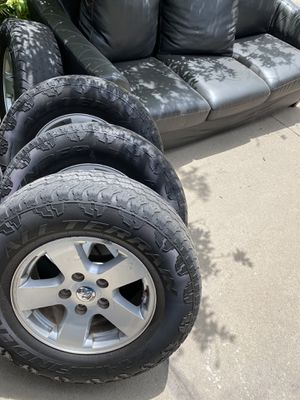 """Stock 17"""" wheels And tire Dodge Ram 1500. $300 for Sale in Broomfield, CO"""