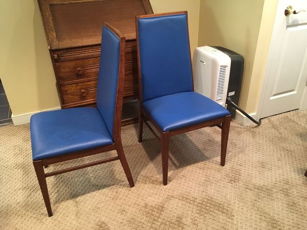 Two Solid Vintage Danish Wooden Chairs that could use reupholstered.