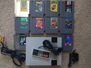 10 NES games with a Nintendo Entertainment System for Sale in Austin, TX