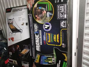 Arcade gaming system brand new in the box includes 4 games built into one arcade system for Sale in Seattle, WA