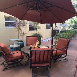 Fire Pit Patio Set w/4 chairs and heavy duty Solar Powered Light Up Umbrella PLUS more for Sale in Fort Lauderdale,  FL