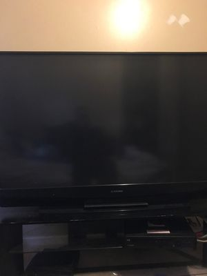 60 inch come with tv stand for Sale in Warren, MI