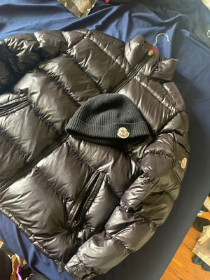 Moncler size small jacket and matching moncler hat for Sale in Silver Spring, MD