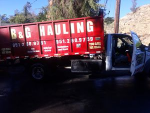 Clean tilte up to date tags runs great no engine lights smoged nice dump truck keyless remote on dump bed and trailer for Sale in San Jacinto, CA