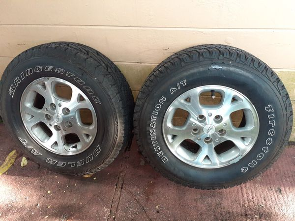 5 Bridgestone 245 70r 16 5 lug dueler all terrain all 5 wheels and tires. Tires are at about 80 % in great condition