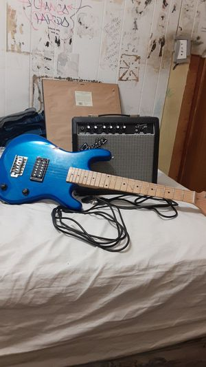 Fender Frontman 15G amp. With quarter inch cable, and power source. And a beginner's guitar. for Sale in Chicago, IL