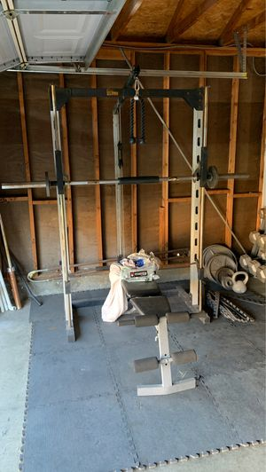 Smith machine weight plates dumbbells for Sale in Palmdale, CA