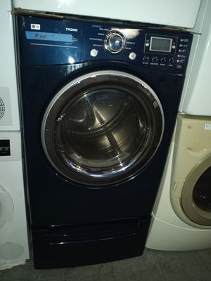 LG TROMM ELECTRIC DRYER WITH PEDESTAL WORKING PERFECT W/4 MONTHS WARRANTY for Sale in Baltimore, MD