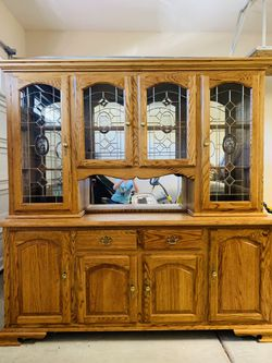 Solid oak China cabinet with lights and glass shelves excellent condition, 7 feet wide by 8 feet tall for Sale in Las Vegas,  NV