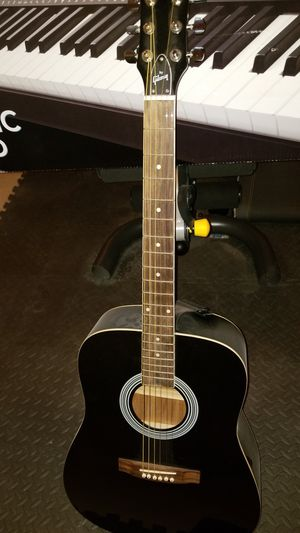 Acoustic Guitar with soft case, clip, and strap to hold guitar while playing for Sale in Frederick, MD