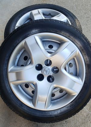 Set of 4 Tires with hubcaps for Sale in Colonial Heights, VA