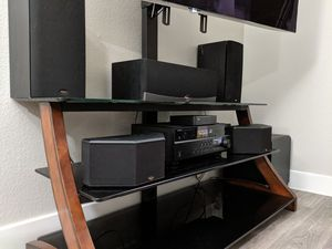Tv stand and 5.1 Klipsch surround sound with wireless subwoofer and wireless rear speakers for Sale in Phoenix, AZ