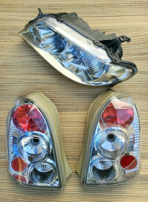 Mazda Protege5 headlight & clear taillights 2002-2003 located in Mira Mesa 92126 for Sale in San Diego, CA