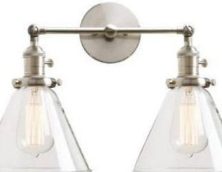 Wall lamp with 2 arms and 2 glass shades. Can be installed with bulb up or down. for Sale in Ontario,  CA