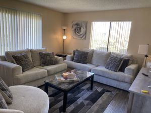 Ashley Furniture : Couch , Love sweat , Single Spin Chair , 2 End Tables , 1 Coffee Table and Rug for Sale in Victorville, CA