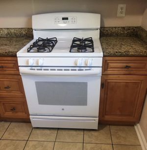 White GE Gas Range & Whirlpool Microwave for Sale in Fort Washington, MD