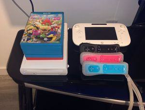 Wii U with 3 regular controllers, 1 nunchucks, 1 pad controller with display for Sale in Port St. Lucie, FL