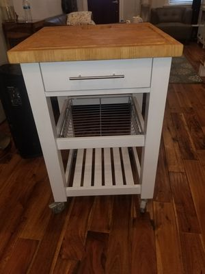 Kitchen storage island with top cutting board on wheels for Sale in Washington, DC