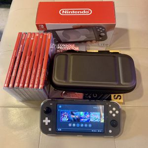 Grey Nintendo Switch Lite With Games And Extras $460 for Sale in Montesano, WA