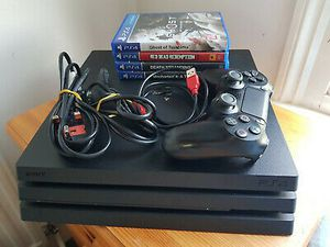 Sony Playstation 4 Pro (PS4 Pro) 1TB Game Console with Controller and 4 Games for Sale in Lake Charles, LA
