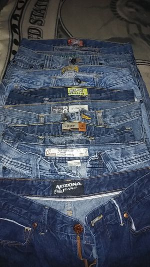 8 pairs of boy's size 14 jeans all in excellent if not perfect condition. + 1 boys extra large 18 to 20 Nautica long sleeve plaid shirt. for Sale in Lawrenceville, GA