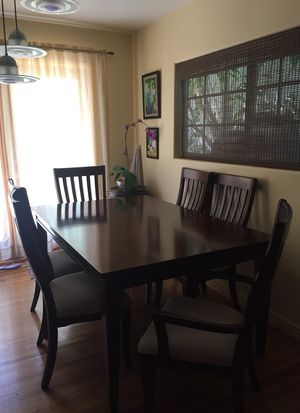Cherry wood dining table with 6 chairs. Includes leaf extension. for Sale in Los Angeles, CA