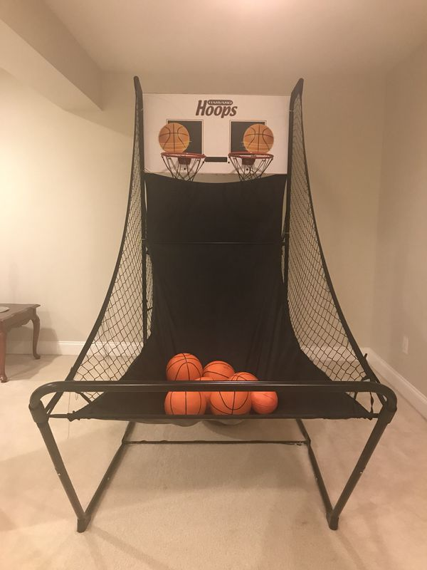 Arcade basketball hoop and air hockey table