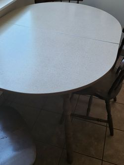 Mid century wood and laminate kitchen table with 1 one-foot extension, 4f or 5 ft x 3 with 3 wooden chairs for Sale in Anaheim,  CA