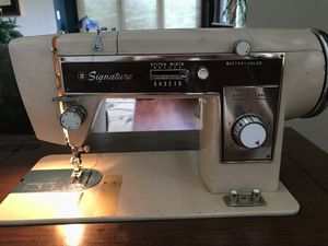 Vintage signature sewing machine and cabinet pristine condition for Sale in Boulder, CO