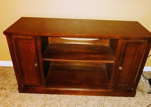 Pruitts TV table with adjustable shelves behind cabinet doors for Sale in Phoenix, AZ