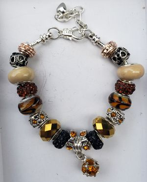 Brown, black gold charm bracelet 2 for $25 for Sale in Baltimore, MD