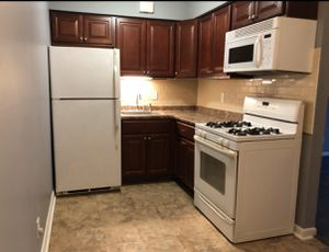 Entire kitchen 4sale, Cherry wood cabinets, refrigerator, range, microwave for Sale in Philadelphia, PA
