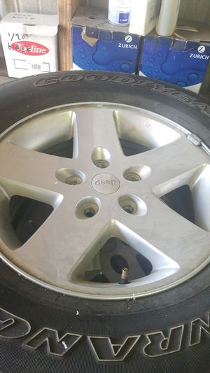 2011 jeep wrangler wheels and tires for Sale in Reedley, CA