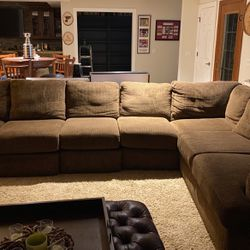 Large Light Brown Sectional . 1 Coffee Table With Matching End Table And Lamp Measure Meets available Upon Request for Sale in Chesterfield,  MO