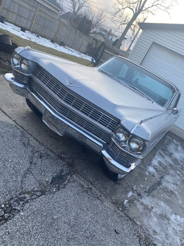 1964 Cadillac deville 90k miles clean title in hand/trade for boat