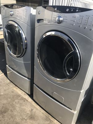 Silver color washer and dryer with pedestals for Sale in La Habra, CA