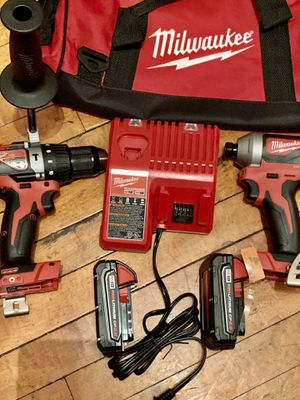 MILWAUKEE M18 INCLUDED HAMMER DRILL IMPACT DRIVER 2 battery charger for Sale in Chicago, IL